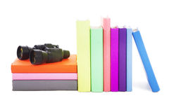 Books and binocular Royalty Free Stock Photos
