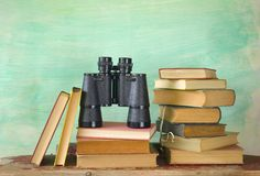 Books with binoculars Stock Photo