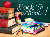 Books and blackboard. School supplies. Stock Images
