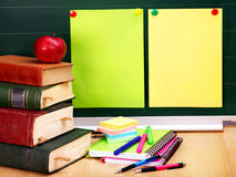 Books and blackboard. School supplies. Royalty Free Stock Photo