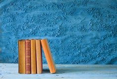 Books on blue background Royalty Free Stock Image