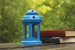 Books and blue lamp Royalty Free Stock Images