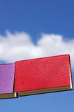 Books and blue sky. Books displayed with the blue sky in deep Stock Photo