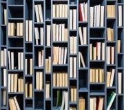 Books on blue wooden bookshelf Royalty Free Stock Image