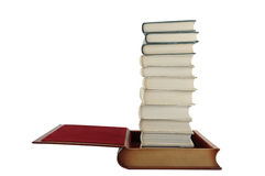 Books in book. Stacked books in one big empty book isolated on white background Royalty Free Stock Photo