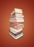 Books. Book stack isolated on brown background Stock Images