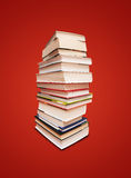Books. Book stack isolated on red background Stock Photos