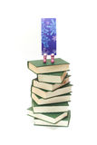 Books. Bookmark stands on pile of books Royalty Free Stock Image