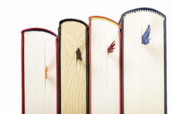 Books with bookmarks standing in row against white background Stock Photography