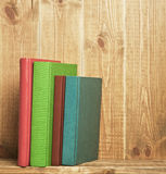 Books on bookshelf Stock Images