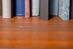 Books in the bookshelf Stock Photos