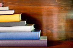 Books in the bookshelf. A detail of books in the bookshelf royalty free stock image