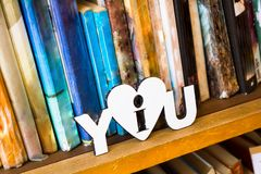 Books on a bookshelf in the library Royalty Free Stock Photos