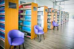The Books On Bookshelf And Purple Chairs In Interior Library Of University Royalty Free Stock Images