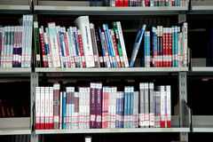 Books in bookshelf. A bookshelf in a University library . china stock photography