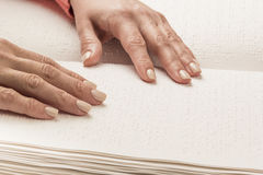 Books Braille. The touch of your fingertips the texture of the p Stock Images