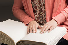 Books Braille. The touch of your fingertips the texture of the p Royalty Free Stock Photo