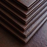 Books in a brown leather cover Royalty Free Stock Images
