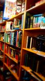 Books in Brown Wooden Shelf Indoors Royalty Free Stock Photography