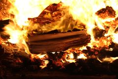 Books burn in fire like cathedrals or paper on secret documents like a meteorite in the atmosphere burns in seconds. Fire furnace horn heat the temperature of royalty free stock photo