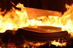Books burning in the furnace mysterious mystical furnace stock photos
