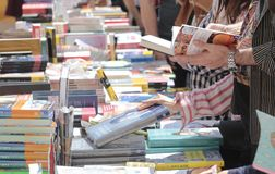 Books fair in mallorca. Books and buyers on a crowded street sale market stand during the books day in the island of Mallorca, Spain Royalty Free Stock Photos