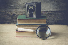 Books, camera, and magnifying glass on retro background with Ins Stock Photography