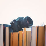 Books and camera Stock Photos