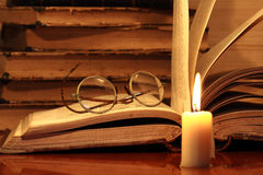 Books And Candle Royalty Free Stock Photos