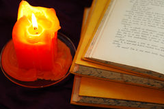 Books with candle Stock Photos