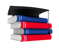 Books with cap. Red and blue books with black cap isolated Royalty Free Stock Image