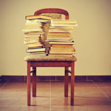 Books on a chair, with a retro effect Stock Photo