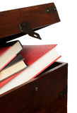 Books in the chest. Books in the wooden chest isolated on white Stock Photography