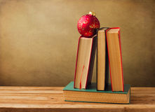 Books and Christmas decorations Stock Images