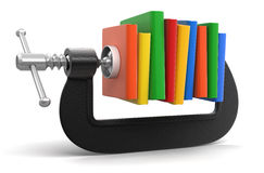 Books in clamp (clipping path included) Stock Images