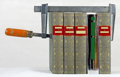 Books clamped with a clamp Stock Photo