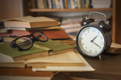 Books with clock Stock Image