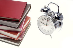 Books and clock Royalty Free Stock Images