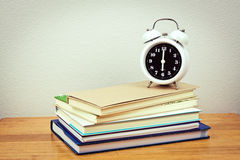 Books and clock Royalty Free Stock Photography