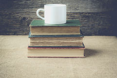 Books  with coffe cup on retro background with Instagram Style F Stock Images