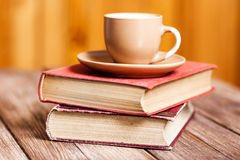 Books and a coffee cup Stock Images