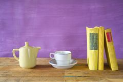 Books, coffee pot and a cup of coffee, Royalty Free Stock Photos