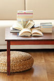 Books on coffee table Stock Photos