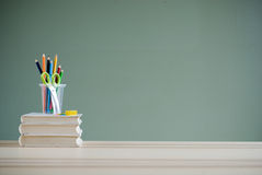 Books and color pencils Stock Photography