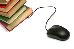 Books and the computer mouse. Stock Photo