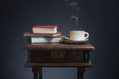 Books and a cup of coffee. Royalty Free Stock Photo