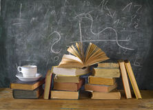 Books, cup of coffee, blackboard, diagram Stock Photo