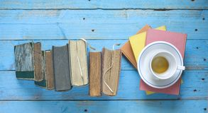 Books and a cup of coffee royalty free stock image