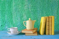 Books with cup of coffee Stock Images