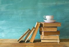 Books with a cup of coffee. Vintage books with coffee cup, grungy background, free copy space Royalty Free Stock Images